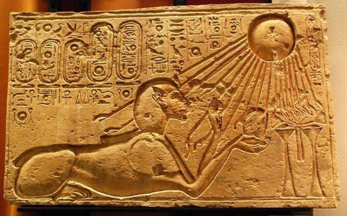 An illustration from ancient Egypt where we see the worship of the sun disk Aten.
